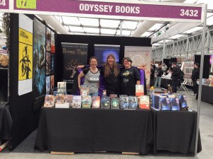 From left to right: Rachel Drummond (zombie queen), Jenny Ealey (sorceress) and me (rocking the Yoda t-shirt) in the Odyssey Books booth at OzComicCon, Sydney.