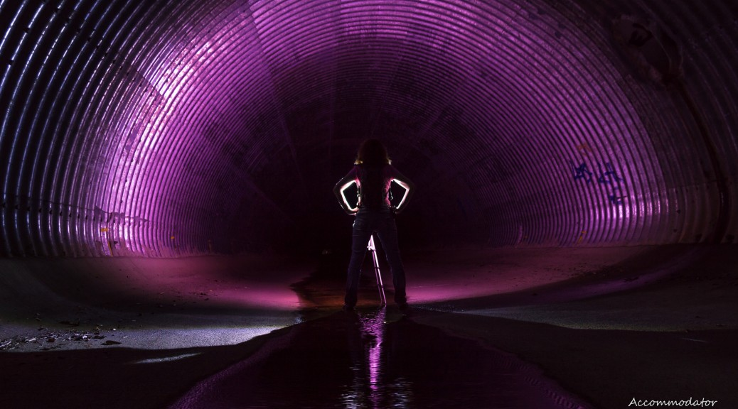 Girl silhouetted in tunnel