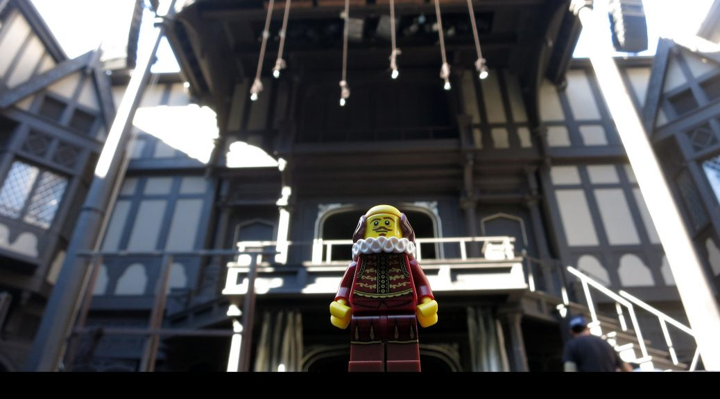 Lego Shakespeare standing in front of Lego Globe Theatre