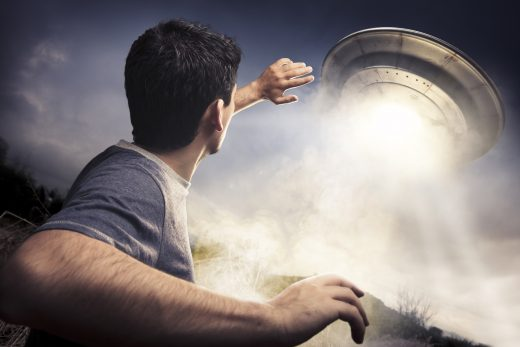 Man watching a UFO
