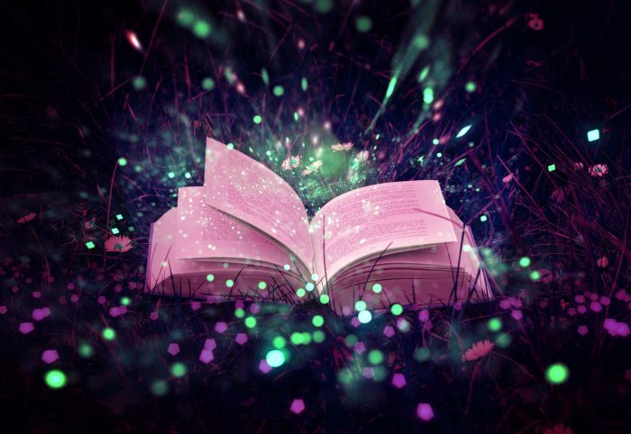 An open book with magic sparkles coming out of the pages.