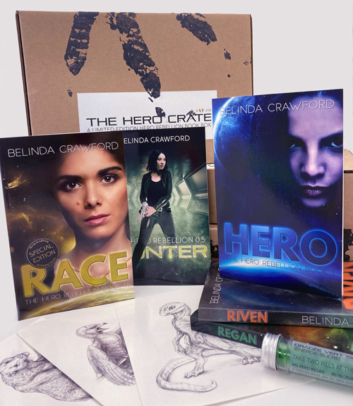 The Hero Crate, fully loaded with the entire Hero Rebellion trilogy plus the novellas Race and Hunter. Also comes with original illustrations, candle melts and more!