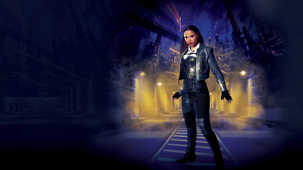 Wallpaper based on the cover art from Hero (The Hero Rebellion 1). Features Hero in a short leather jacket and pants standing in an empty roadway lit by floodlights.